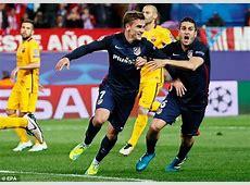 Lionel Messi and Atletico Madrid's Antoine Griezmann go