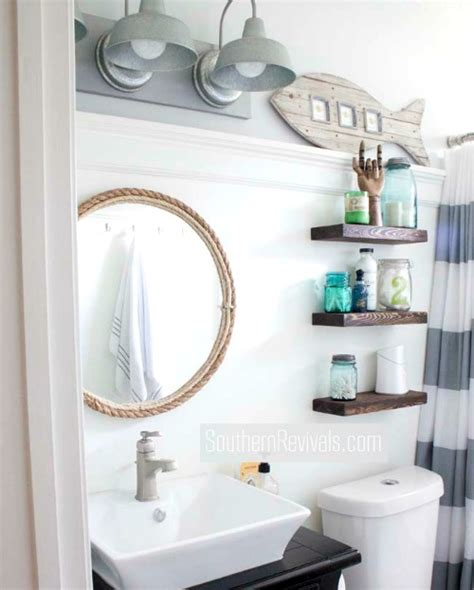 Are you looking for easy bathroom wall decor ideas that will transform a boring space into a beautiful one? Small Nautical Bathroom Makeover with DIY Ideas - Coastal Decor Ideas and Interior Design ...