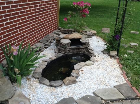 fish pond waterfall ideas small fish pond with pebbles and stones and waterfall background pinterest fish ponds