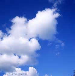 Blue sky with puffy white clouds photo - WP00902