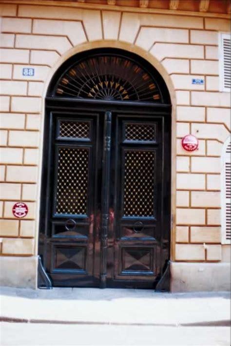 glossy black double exterior doors  fanlight  arrows door  window