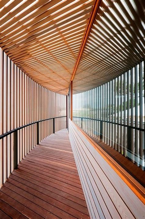 rectangular wooden house  slatted circular facade