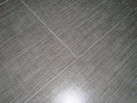 Gray linen floor tile I love the linen tile look.   b a t