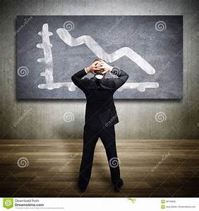 Businessman Looking At A Dropping Diagram Stock Image