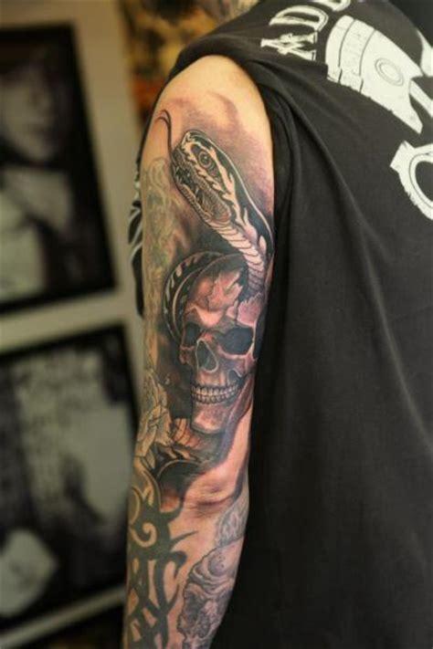 Arm Snake Skull Tattoo by Diamond Jacks