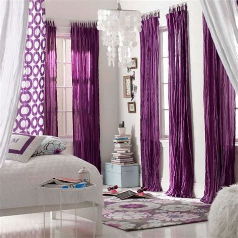 purple curtains and sheer curtains on