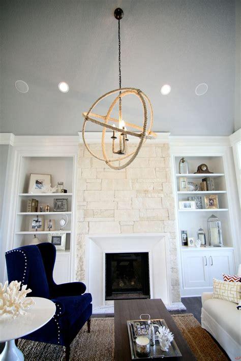 built  shelving   white stone fireplace