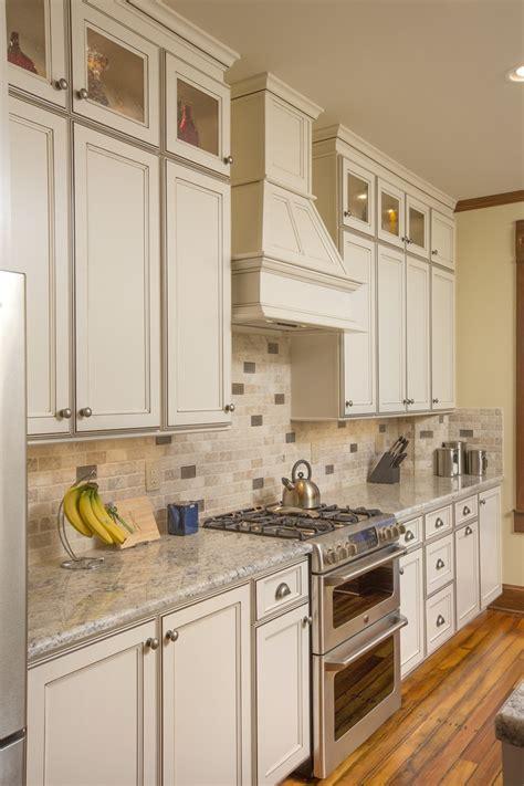 kitchen with travertine floors 2x4 travertine backsplash w random mocha glass insets 6556