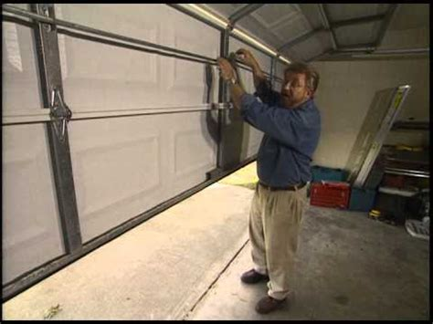 How To Put On Garage Door by How To Install A Garage Door Opener