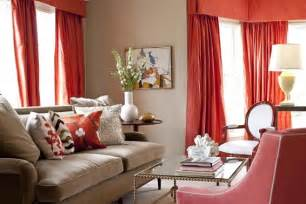 beige and coral living room with curtains and armchair modern contemporary fresh