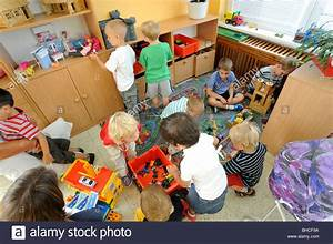 Preschool children playing in class with toys Stock Photo ...