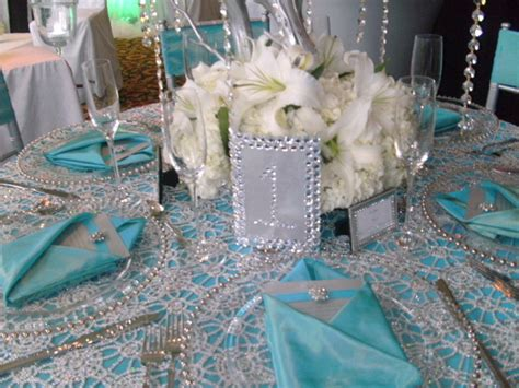bling and feathers for wedding ideas teal silver bling tablescape inspiration
