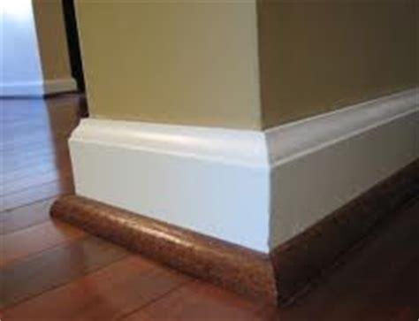trim baseboard molding   laminate floor
