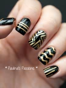 Paulina s passions dc day black and gold stripes nail art