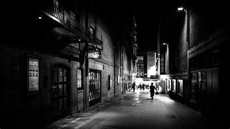 A man walking at night  London, England  Black and white