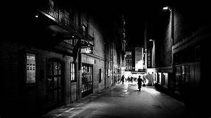A man walking at night - London, England - Black and white ...