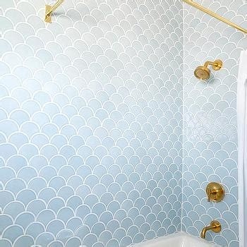 blue shower surround with brushed gold shower kit