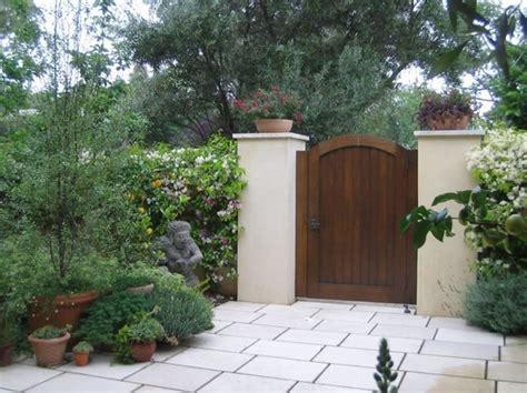 stucco fence ideas simple white stucco wall black wrought iron gate mediterranean style pinterest stucco