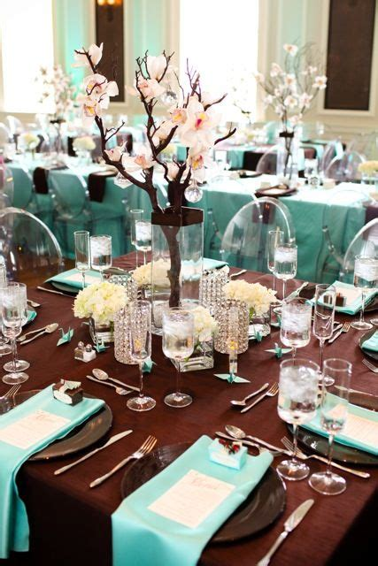 teal blue rocks on the bottom of vase and to white ombre flowers on the tree to match