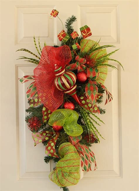 christmas swag wreath made with pine greenery and deco