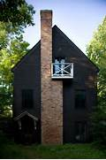 Black Color House Unusual Interior Painted In A Dark Charcoal Paint Color The Exterior Of This Cottage