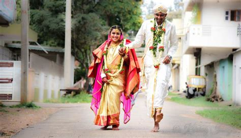 South Indian Bride And Groom Wearing Traditional Outfits