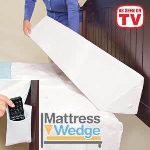mattress wedge fills the gap between the headboard and the bed With bed wedge to keep pillows from falling