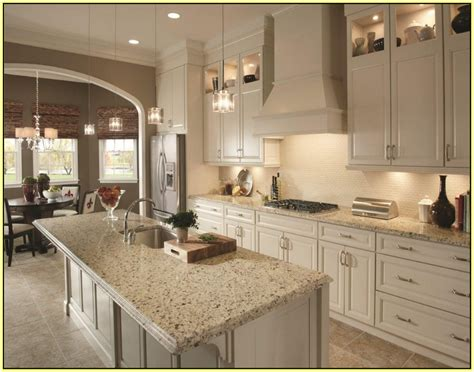 crema pearl granite search with golden oak