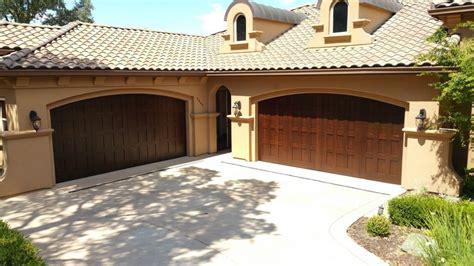 installing custom wood carriage house garage doors