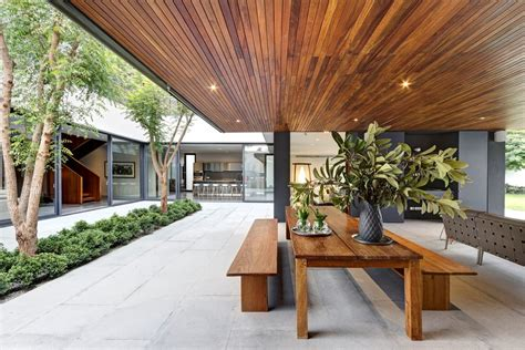 Exterior Wood Ceiling Planks by Steel Concrete And Home With Central Courtyard