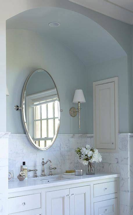 arched bath vanity nook  blue walls transitional