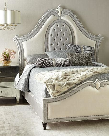 white  silver upholstered curved queen bed