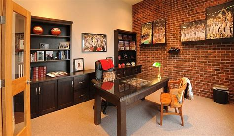 Keep sofas and chairs neutral to balance out the strong colors. Trendy Textural Beauty: 25 Home Offices with Brick Walls