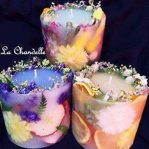 Put candle in a smaller container and add flowers to the