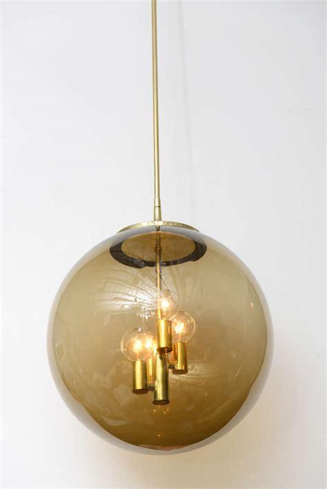 brass globe pendant light 60 s brass globe pendant light at 1stdibs
