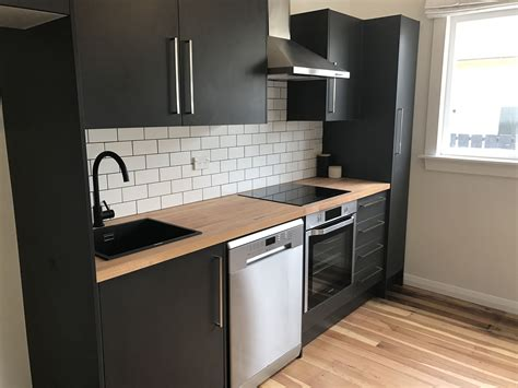 matte black kitchen joinery black fittings warmed up