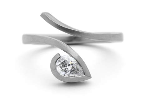 twist platinum engagement ring with pear shaped