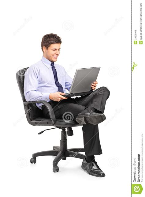 businessman sitting in office chair stock photos