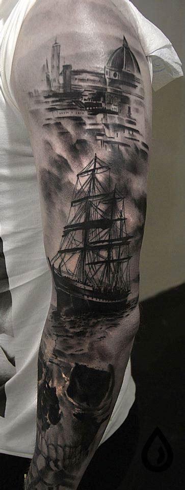 black ink ship  skull tattoo  left full sleeve