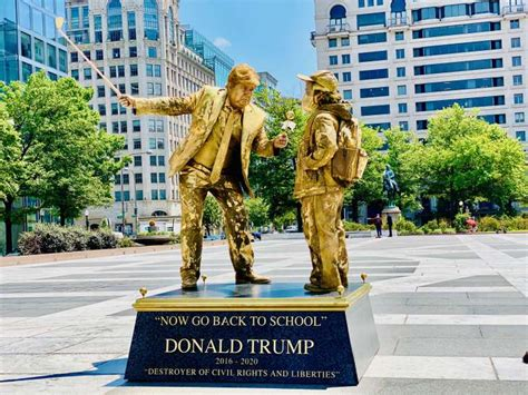 golden statues memorializing donald trumps