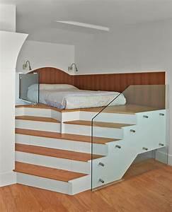 Delightful Elevated Platform Bed With Beige Art Work