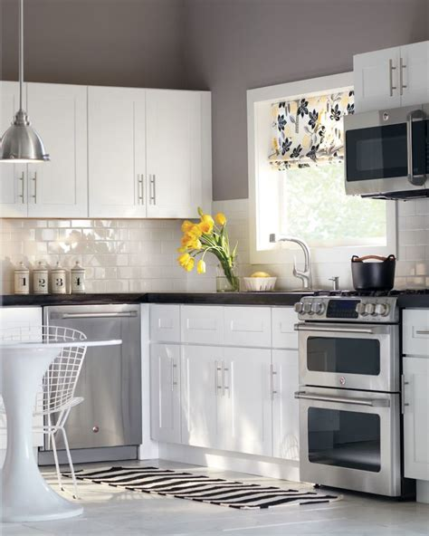 kitchen gray walls white cabinets light fixture wall color white cabinets subway tile 8113