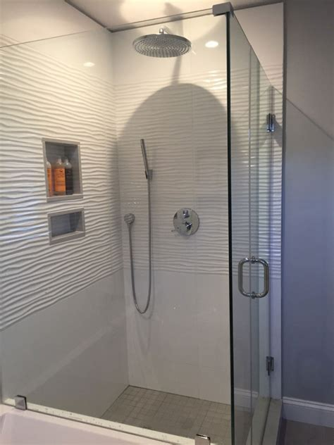How To Refinish Bathroom Tile by White Wavy Tile Tile Designs