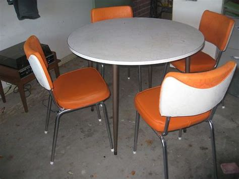 table with 4 white orange chairs 1950s 60 dining