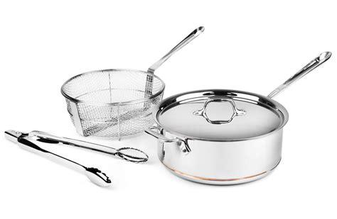 clad copper core deep saute pan  fry basket tongs  quart cutlery