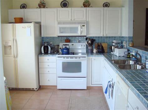 White Kitchen Cabinets And White Appliances Decor