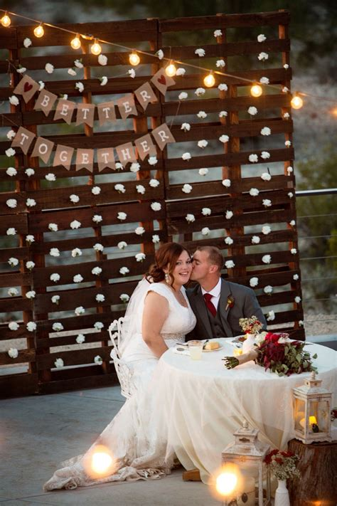 Pallet Wall With Hanging Carnations Wedding Backdrop Diy