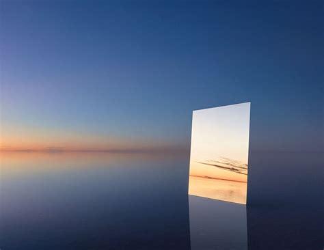 photographer put  huge mirror   salt flat  capture