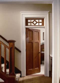 stained doors  windows  white baseboard