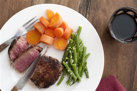 medium rare fillet steak  beans  carrots